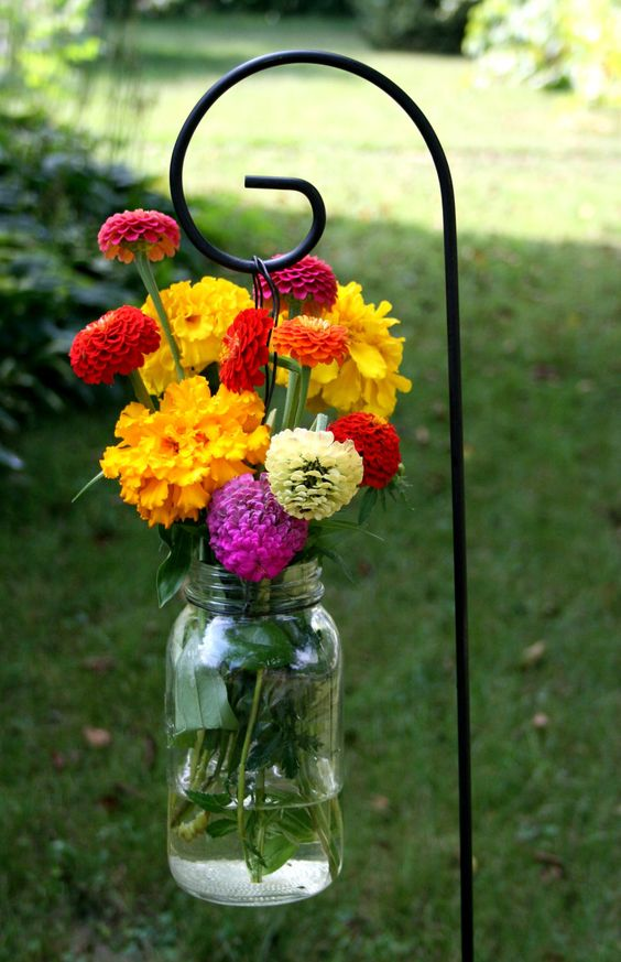 Use Old Mason Jars To Make Stunning DIY Decorations For Your Garden